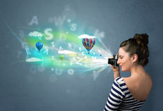Photographer with camera and abstract imaginary Royalty Free Stock Image