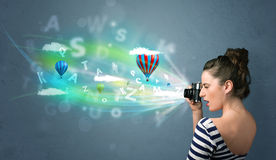 Photographer with camera and abstract imaginary Stock Photo