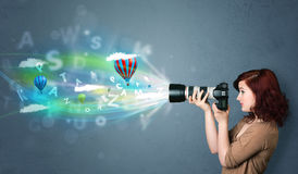 Photographer with camera and abstract imaginary Stock Photography