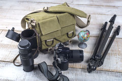 Photographer camera bag and tripod Royalty Free Stock Images