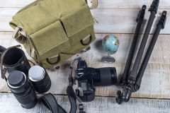 Photographer camera bag and tripod Stock Photography