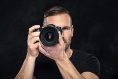 Photographer with camera on black Royalty Free Stock Images