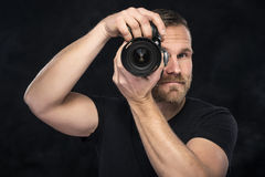 Photographer with camera on black Stock Image