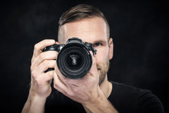 Photographer with camera on black Stock Images