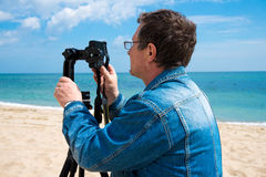 Photographer with camera on the Black Sea Royalty Free Stock Images