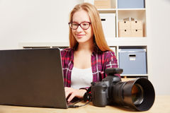 Photographer with Camera and Computer Stock Photography