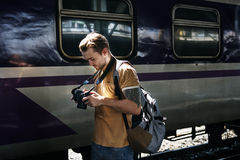 Photographer Camera DSLR Shooting Journalist Concept. Man traveler photographer Journalist Concept Stock Images