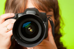 Photographer with camera. Female photographer taking photos with DSLR digital camera Stock Images
