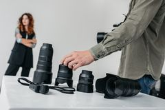 Photographer with camera and lenses Stock Photography