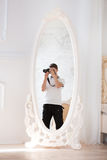 Photographer with the camera in a mirror Stock Image