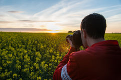 Photographer with camera in nature Royalty Free Stock Photos