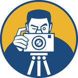 Photographer With Camera Retro. Illustration of a photographer shooting dslr camera front view set inside circle done in retro style Stock Images