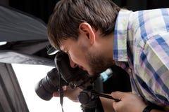 Photographer with camera Stock Photo