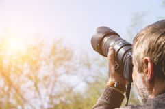 Photographer with camera with telephoto lens Royalty Free Stock Photos