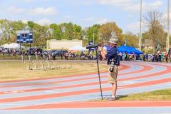 Photographer Captures Track Invitational. Photographer captures a high school track meet invitational in Montgomery, Alabama using telephoto zoom lenses Stock Photos