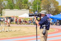 Photographer Captures Track Invitational. Photographer captures a high school track meet invitational in Montgomery, Alabama using telephoto zoom lenses Royalty Free Stock Image