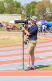 Photographer Captures Track Invitational. Photographer captures a high school track meet invitational in Montgomery, Alabama using telephoto zoom lenses Royalty Free Stock Photos