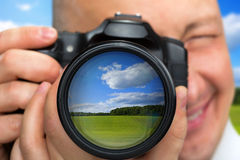Photographer capturing rural landscape Stock Photo