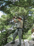 Photographer Capturing The Landscape From A High Overlook In The Sandia Mountains Wilderness Area. Stock Photo
