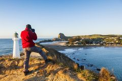 Photographer at Castlepoint Lighthouse New Zealand stock images