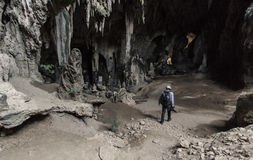 Photographer in the cave. Take when this photographer walk into this cave Stock Images