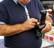 Photographer changing new of negative roll film i. Nto camera. Selective focus Stock Images