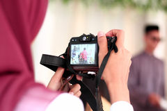 Photographer chases and captures the moment. At wedding ceremony Royalty Free Stock Photo