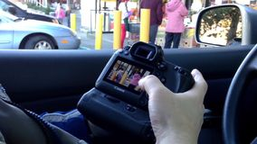 Photographer checking his photo at Canon camera stock footage