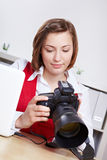 Photographer checking images on Royalty Free Stock Photography