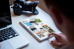 Photographer portfolio tablet. Photographer checking online portfolio on a tablet royalty free stock image