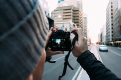Photographer on city streets Stock Photography