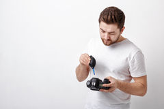 Photographer cleaning camera with vacuum pump. hand blower dust Royalty Free Stock Photos