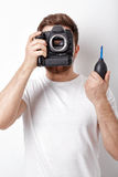 Photographer cleaning camera with vacuum pump. hand blower dust Stock Image