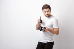 Photographer cleaning camera with vacuum pump. hand blower dust Royalty Free Stock Photo