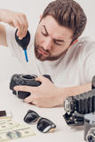 Photographer cleaning camera with vacuum pump. hand blower dust Royalty Free Stock Images