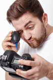 Photographer cleaning camera with vacuum pump. hand blower dust Stock Images