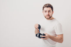 Photographer cleaning camera with vacuum pump. hand blower dust Stock Photography