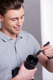 Photographer cleaning the lens. Royalty Free Stock Photography