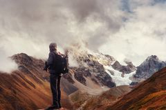Photographer on cliff. Nature takes photos with mirror camera peak of rock. royalty free stock photography