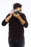 Photographer. Close up portrait of guy holding vintage camera Royalty Free Stock Photo