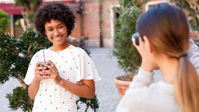 Photographer collaborating with a blogger. Two women creating content for social media stock images