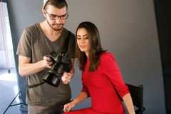 Photographer communicate with model on photoshoot Royalty Free Stock Photo