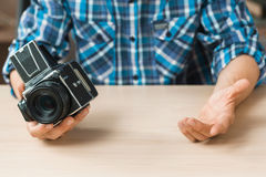 Photographer compare old camera with smth, void Stock Photography