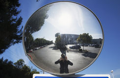 Photographer in concave mirror photographs himself, Ventura, California, USA Royalty Free Stock Images