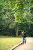 Photographer in country side Stock Photo