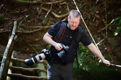 Free Photographer Crosses Bridge Stock Photos - 25231663