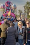 A photographer in the crowd at the Viareggio carnival, Tuscany, Italy royalty free stock photography