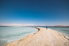 Photographer Dead Sea Israel. Photographer in the middle of the Dead Sea in Israel Stock Photography