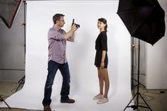 Photographer Demonstrating Studio Photography stock image