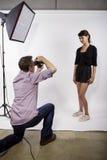 Photographer Demonstrating Studio Photography royalty free stock photo